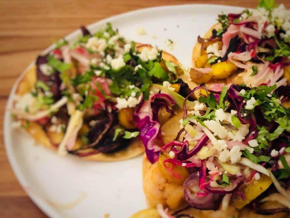 Shrimp and Roasted Carrot Tostadas with Crunchy Slaw and Chipotle Crema