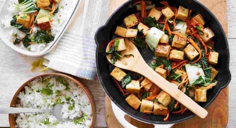 Crispy Sesame Tofu and Bok Choy Stir-Fry with crispy tofu, stir-fried bok choy, and carrots with soy and sesame sauce with scallion jasmine rice