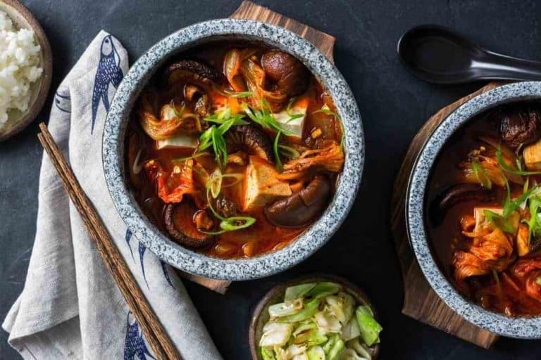Korean jjigae soup with tofu, kimchi, and steamed rice