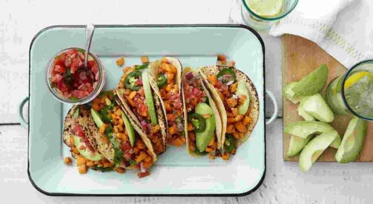 Sweet Potato Tacos with garlic and jalapeno sweet potatoes, pico de gallo, avocado, charred corn tortilla