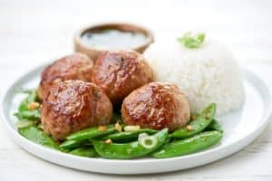 Pork Shumai Meatballs with a ponzu dipping sauce and snap peas