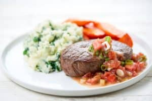 Steak with a Tomato-Marsala Sauce and spinach mashed potatoes and carrots