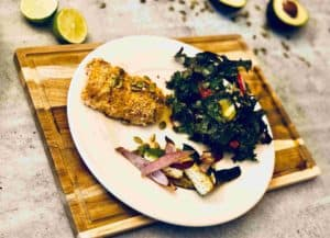 Paprika-cumin cod with roasted zucchini and kale-avocado salad