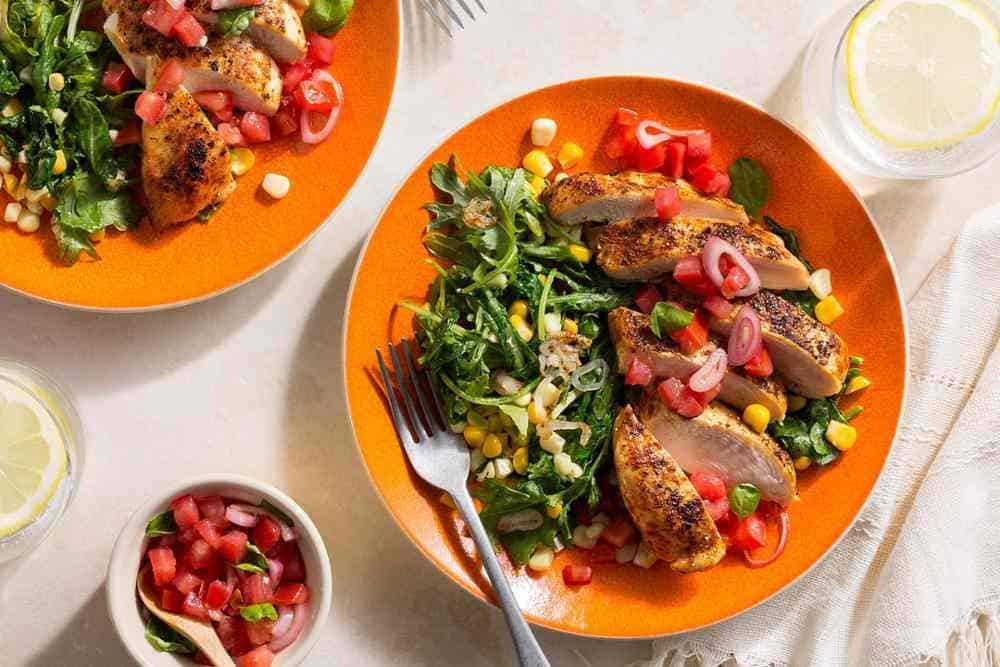 """Paprika-spiced chicken over """"creamed"""" corn with tomato salsa"""