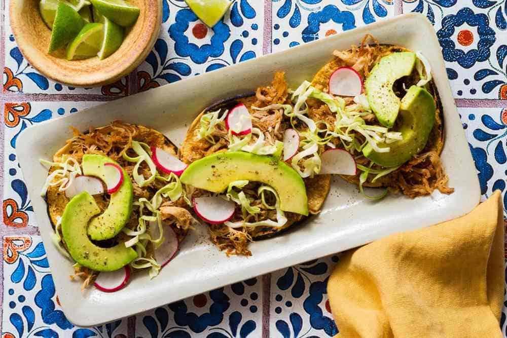 Pork carnitas tacos with cabbage slaw and avocado