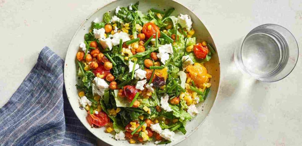 Smoky Chickpea and Kale Salad with Roasted Corn, Tomato, and Feta