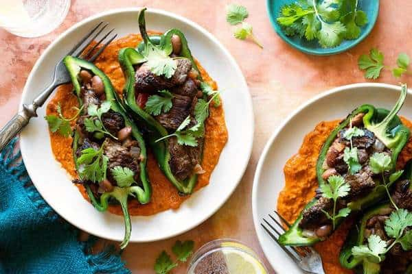 Chiles rellenos with sirloin steak stripes, pinto beans and romesco