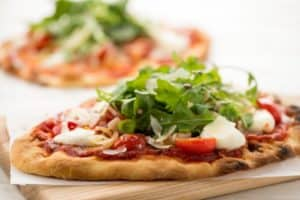 Neapolitan Pizza Margherita with an arugula salad