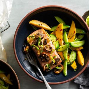 Kyoto salmon and mushrooms in parchment with mango-cucumber salad